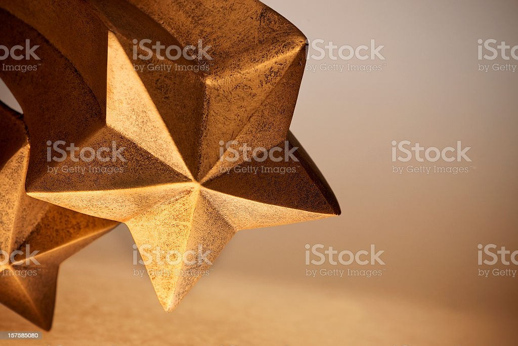 Gold or Bronze Comet Shaped Five Pointed Rising Shooting Stars stock photo