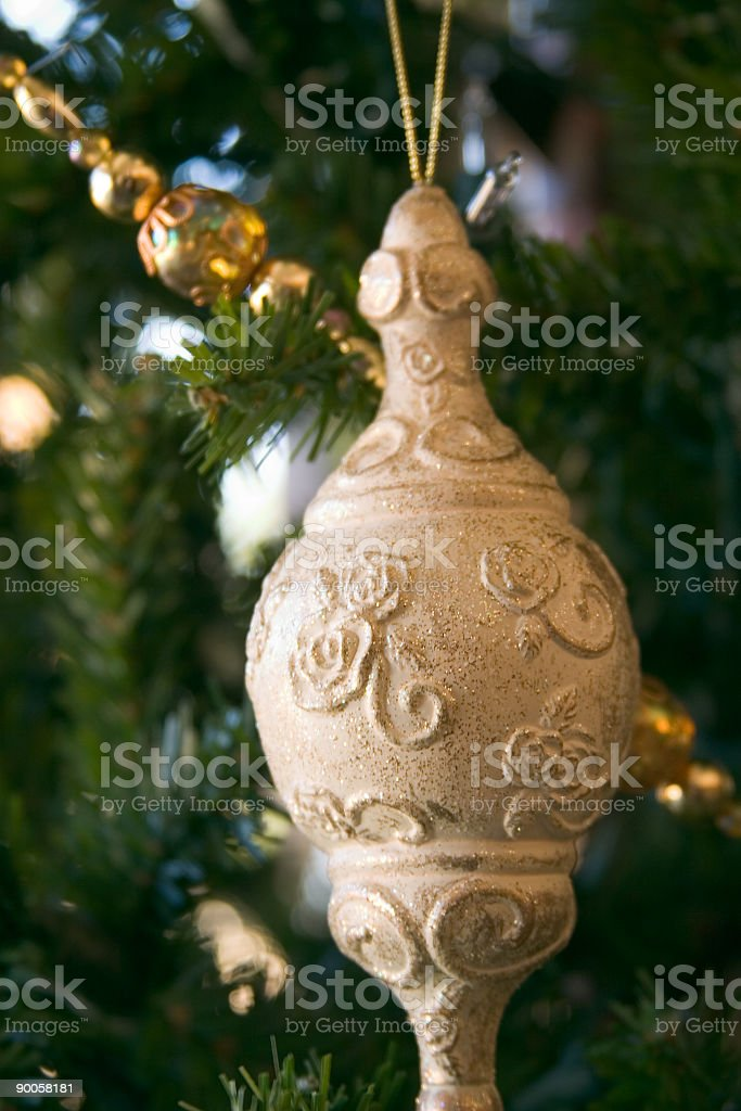 Gold Ornament on Tree royalty-free stock photo