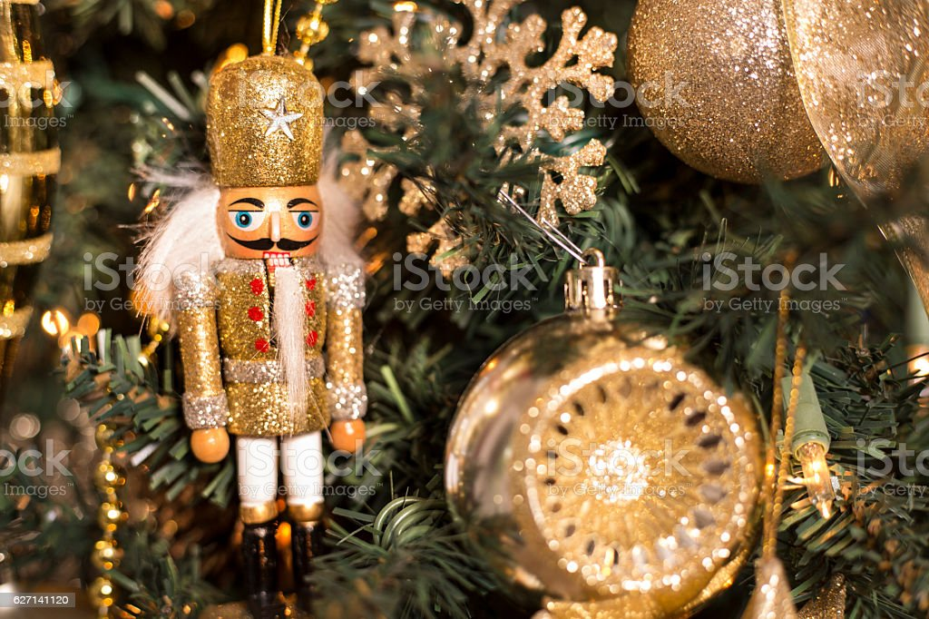 Gold ornaments and decorations on Christmas tree. stock photo