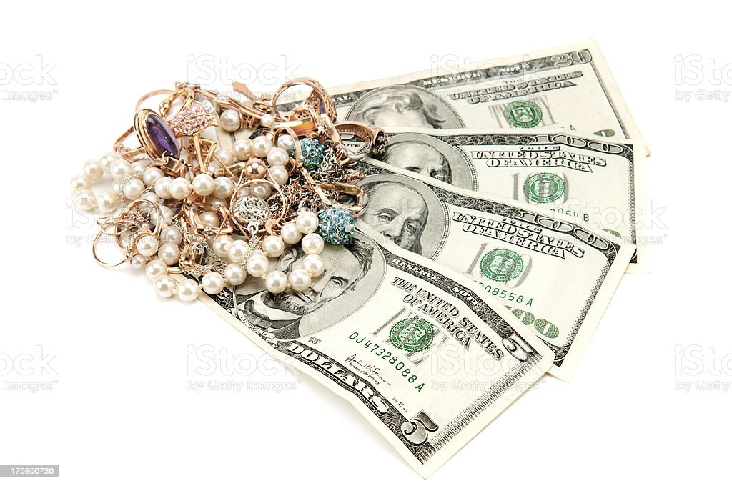 Gold ornaments and dollars isolated on a white background royalty-free stock photo