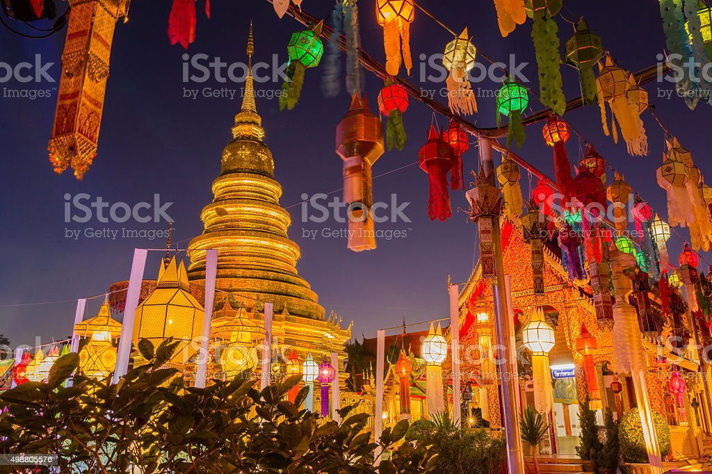 Gold pagoda and lantern hung up on the rail stock photo
