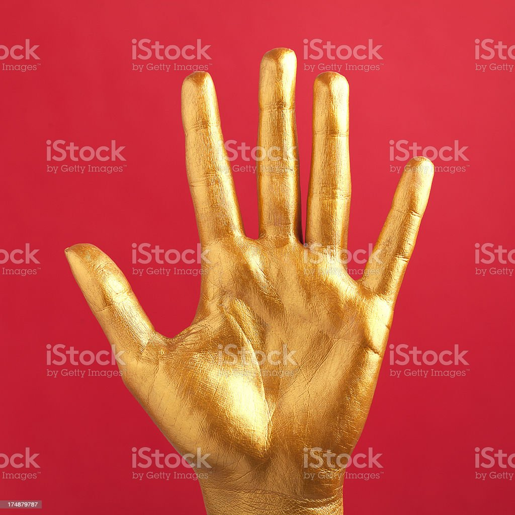gold painted hand royalty-free stock photo