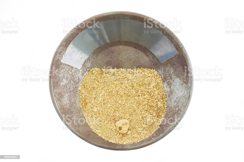 Gold pan filled with natural placer gold stock photo