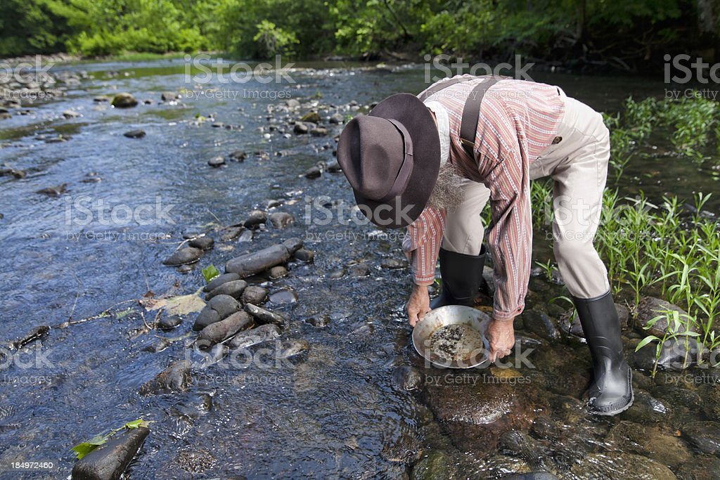 gold panning stock photo