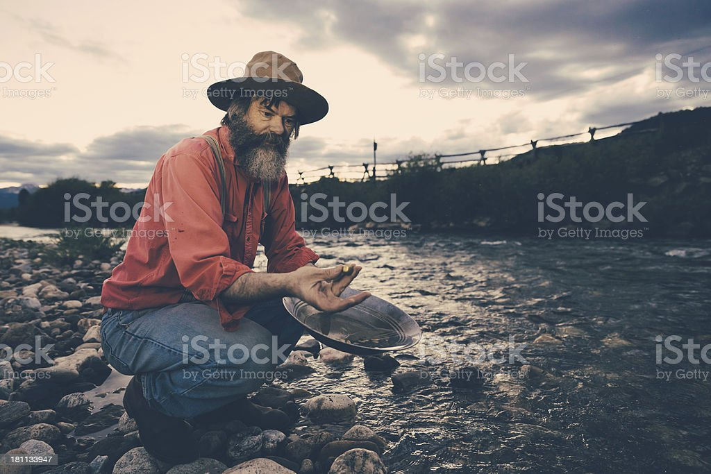 Gold Panning,Successful Prospector with Nugget stock photo