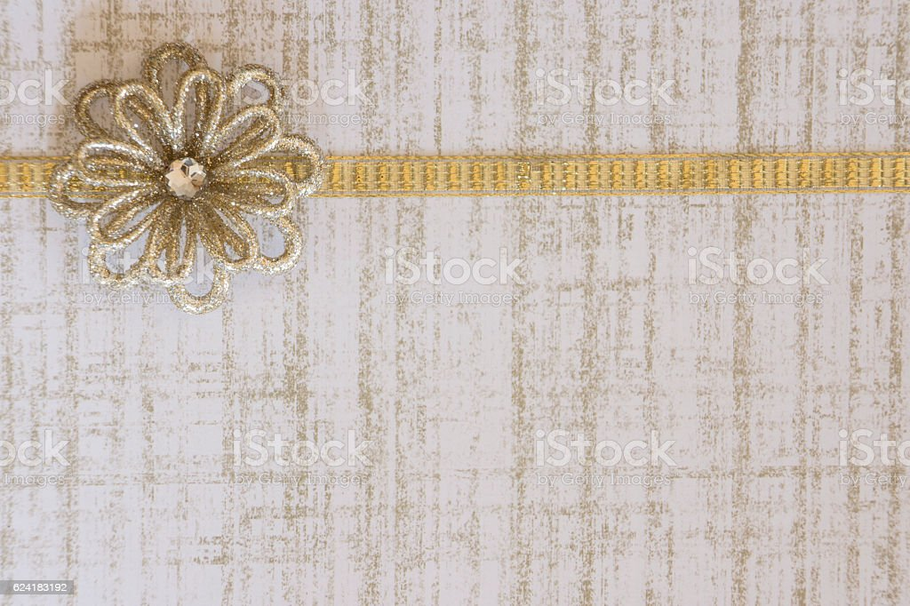 Gold Paper Background with Ribbon Border and Gold Flower stock photo