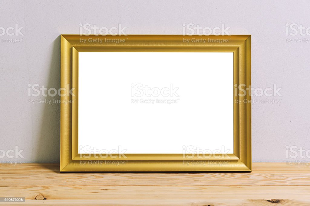 Gold Photo frames on the wood table. stock photo