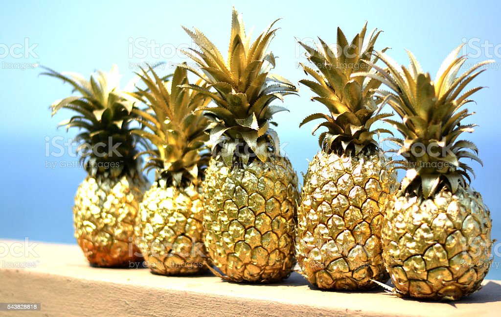 Gold pineapples stock photo