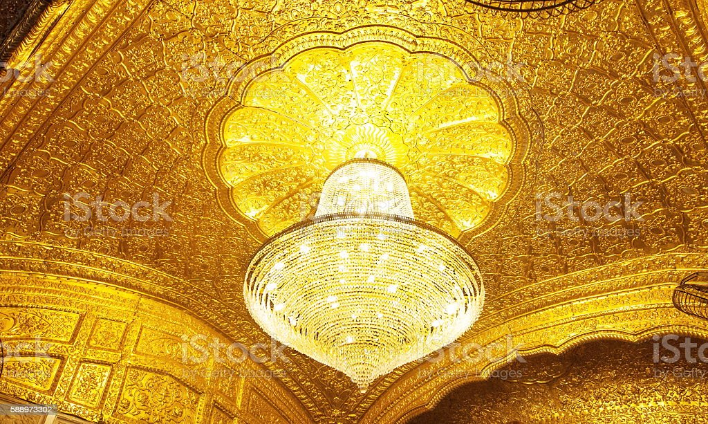 Gold plated wall at entrance gate of Goldel Temple, Amritsar stock photo