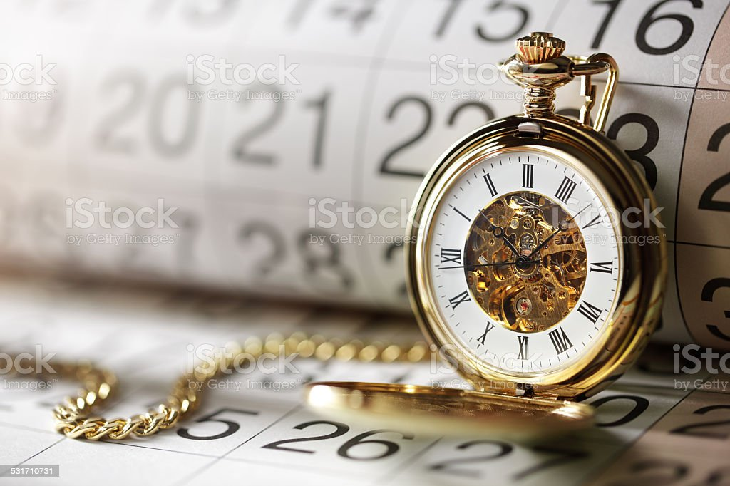 Gold pocket watch and calendar stock photo
