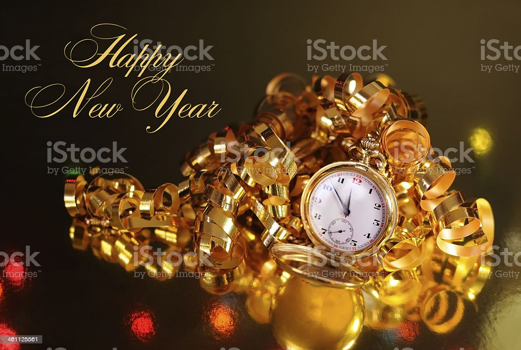 Gold pocket watch ready for midnight on New Years Eve stock photo