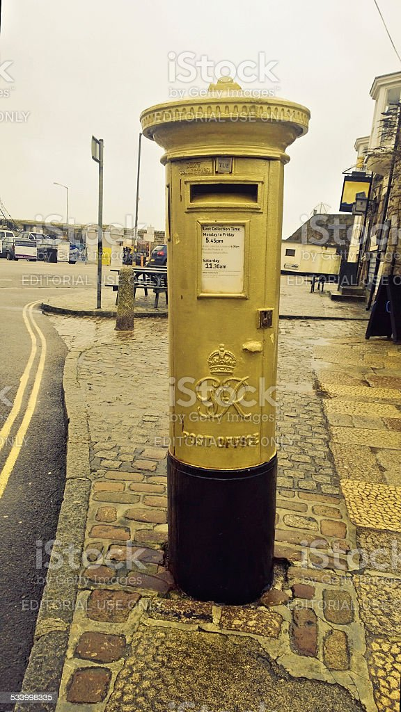 Gold postbox stock photo