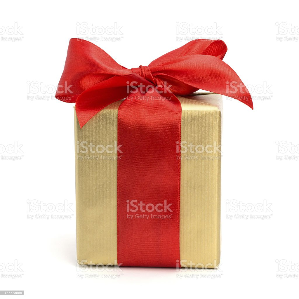 Gold present wrapped with a silk red bow stock photo