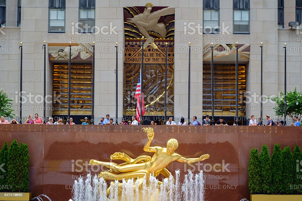 Gold Prometheus statue in Lower Plaza with Rockefeller center stock photo