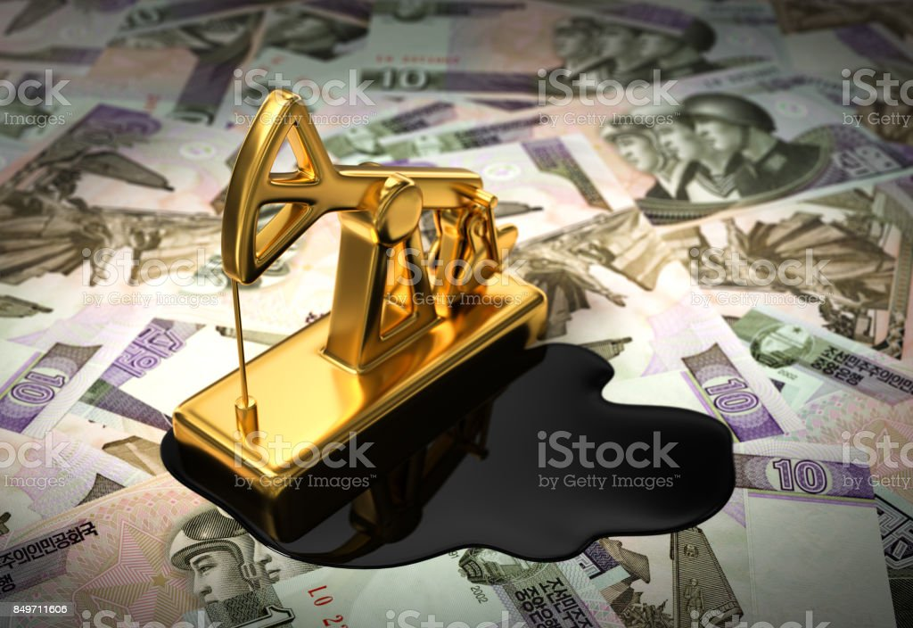 Gold Pumpjack And Spilled Oil On North Korean Wons stock photo