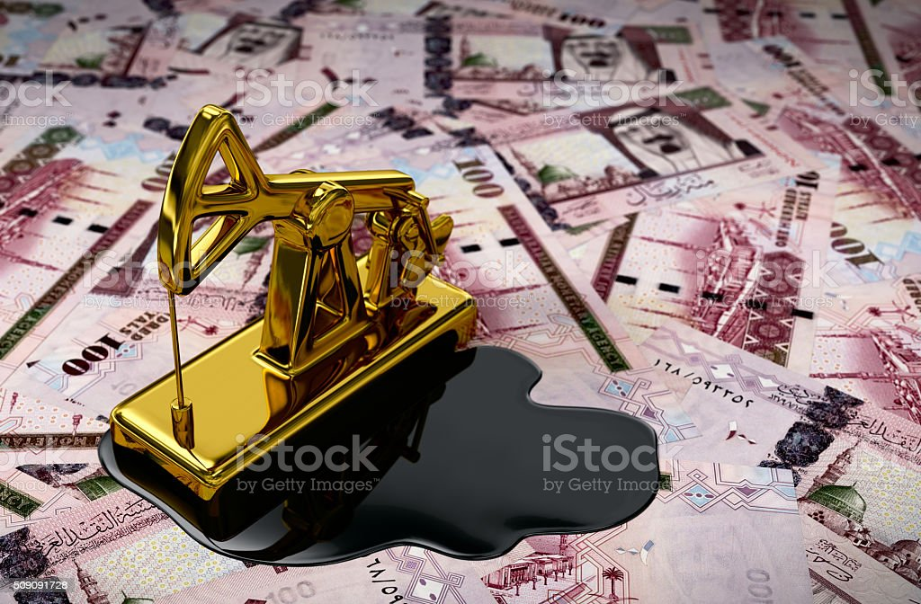 Gold Pumpjack And Spilled Oil On Saudi Riyals stock photo
