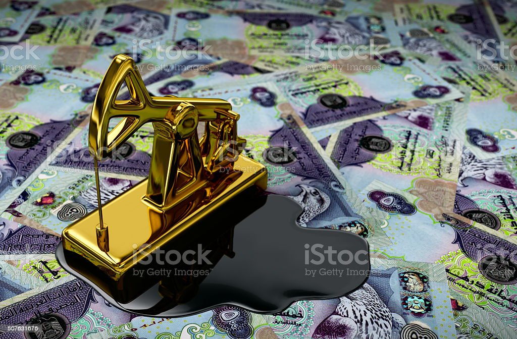 Gold Pumpjack And Spilled Oil On United Arab Emirates Dirham stock photo