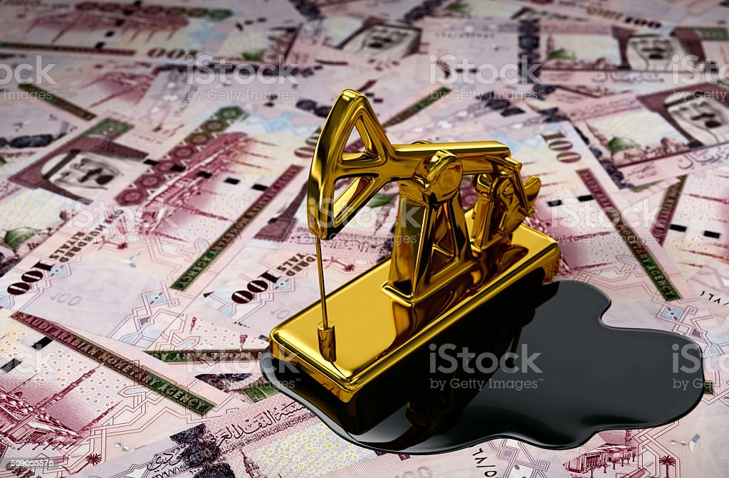 Gold Pumpjack And Spilled Oil Over Saudi Riyals stock photo