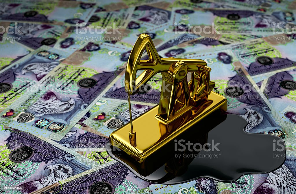 Gold Pumpjack And Spilled Oil Over United Arab Emirates Dirhams stock photo