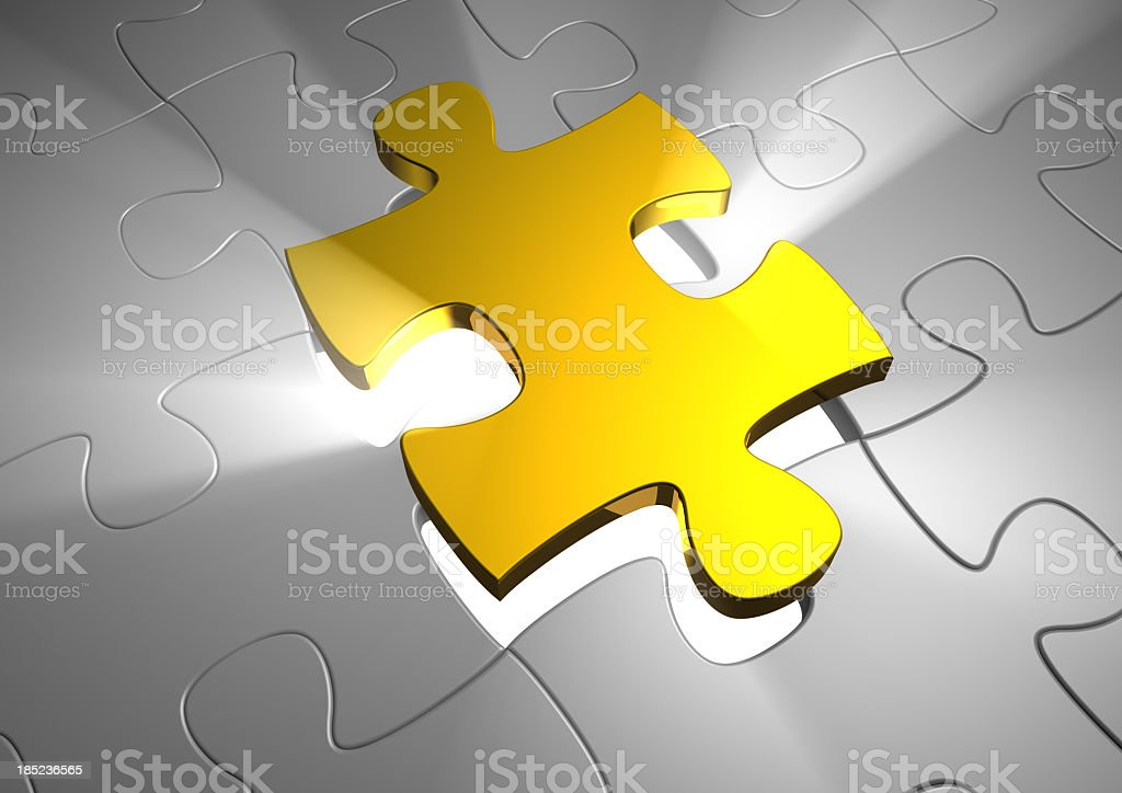 Gold puzzle piece rising above grey pieces royalty-free stock photo