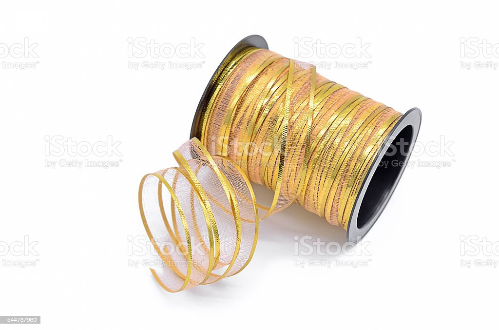 Gold ribbon in black roll stock photo