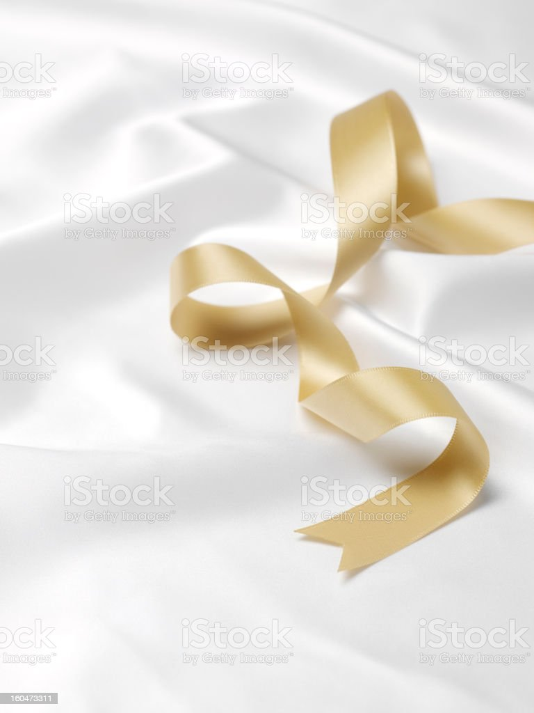 Gold Ribbon on a Silky Material royalty-free stock photo