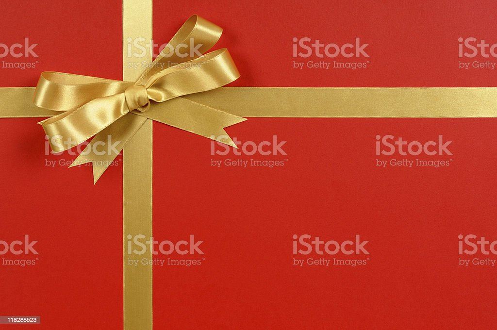 Gold ribbon on red stock photo
