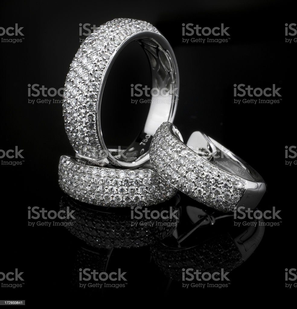 Gold Ring and Earings full of diamonds royalty-free stock photo
