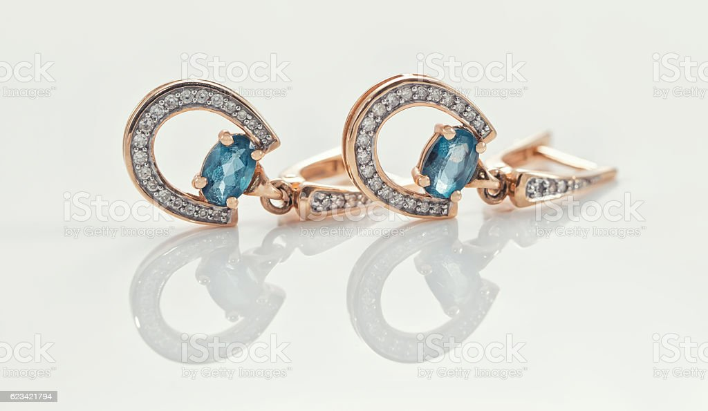 gold ring, earrings and chains stock photo