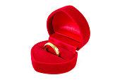 Gold ring in red velvet silk box  with heart shape
