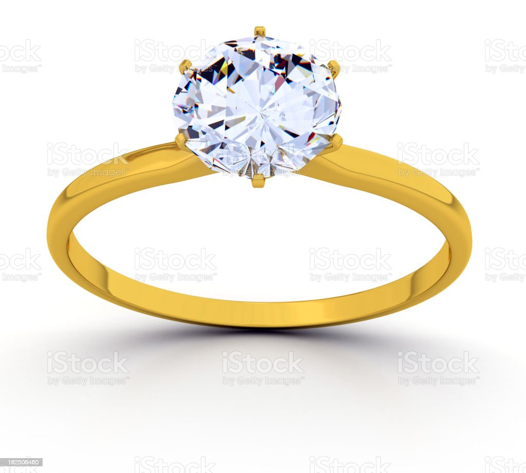 Gold ring with a round diamond solitaire stock photo