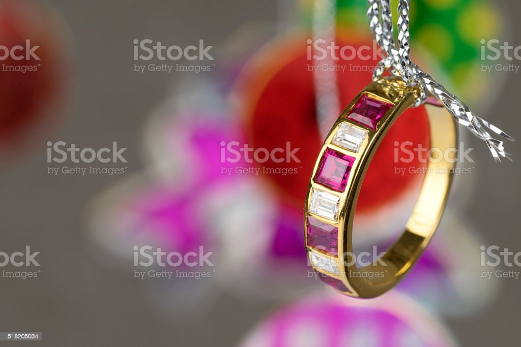 gold ring with square diamond ruby stock photo
