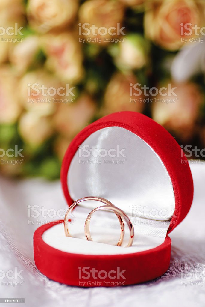 Gold rings and a bouquet of roses stock photo