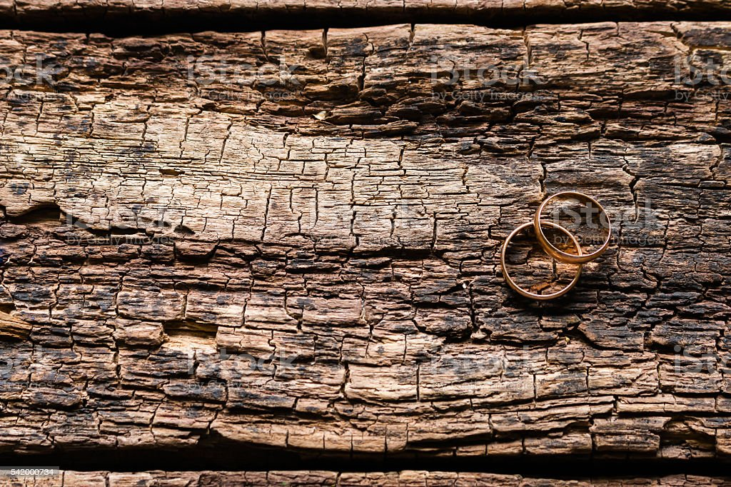 gold rings on a wooden background stock photo