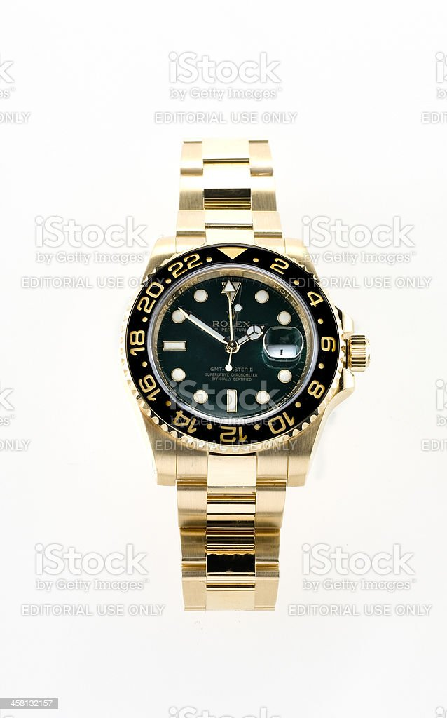 gold Rolex GMT Master 2 wristwatch stock photo
