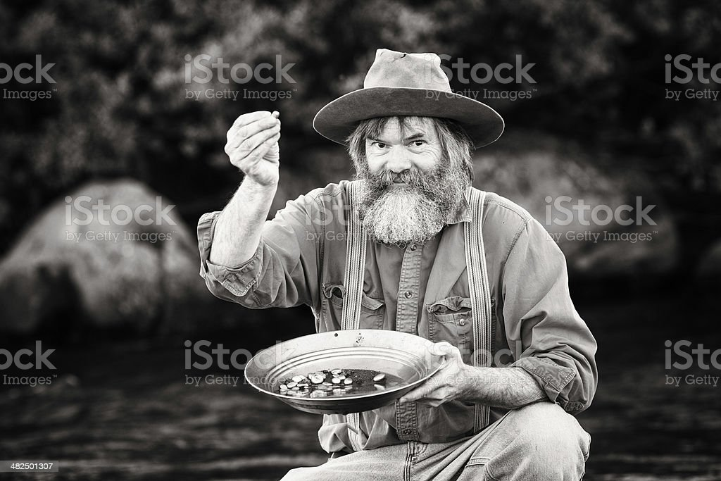 Gold rush prospector showing off his nuggets stock photo