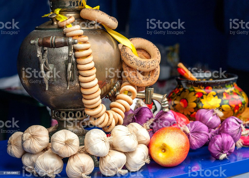 Gold samovar with bagels composition stock photo