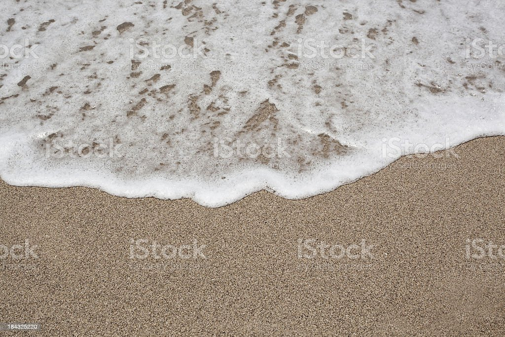 Gold sand and surf royalty-free stock photo