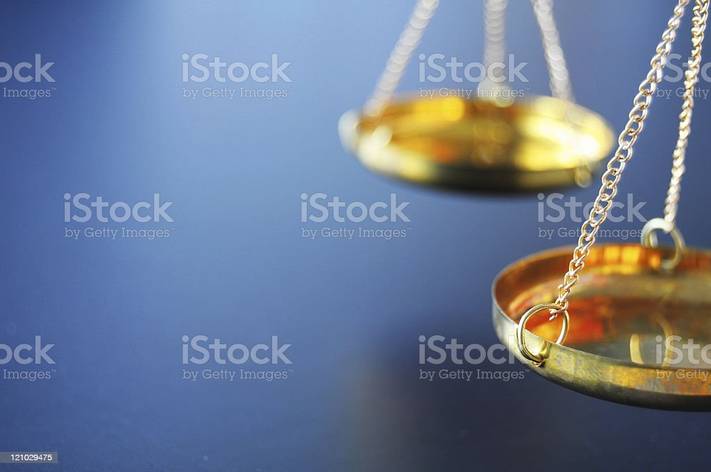 Gold scale to far right of composition with blurred back stock photo