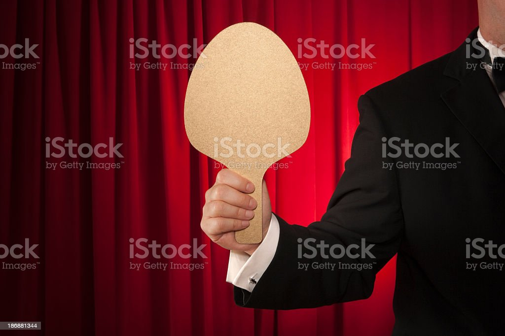Gold score paddle against red curtain royalty-free stock photo