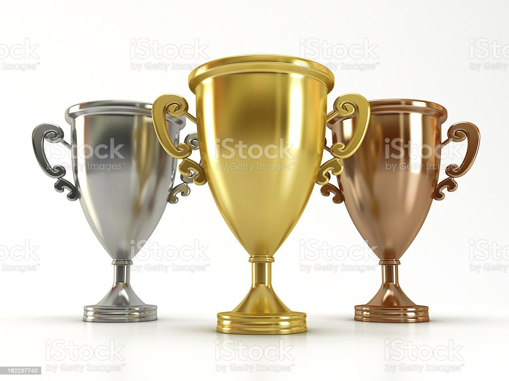 Gold, silver and bronze cups stock photo