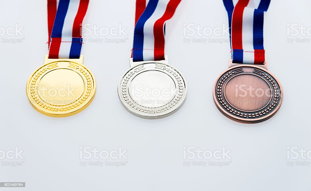 Gold, silver, and bronze medal stock photo