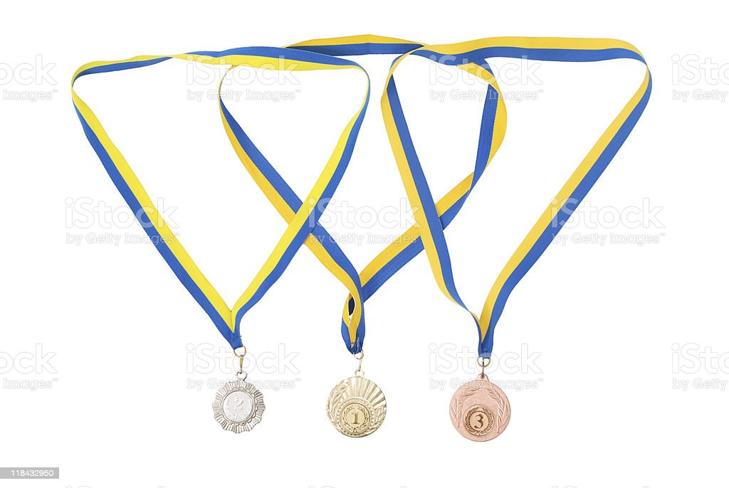 Gold, silver, and bronze medals stock photo
