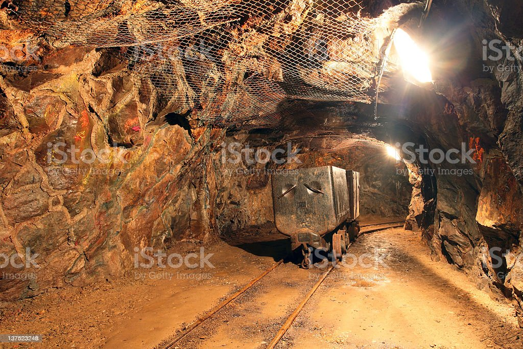 Gold silver and copper mining tunnel with machinery stock photo