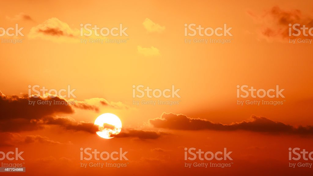 Gold sky and sun stock photo