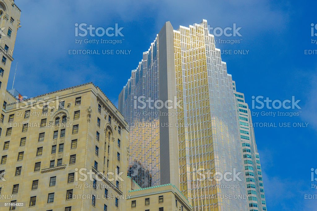 Gold skyscraper and the old fashioned Fairmont Royal York stock photo