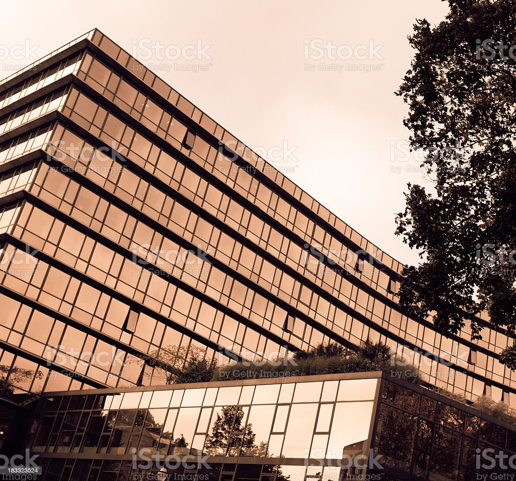 Gold skyscraper with office building and reflecting facade royalty-free stock photo