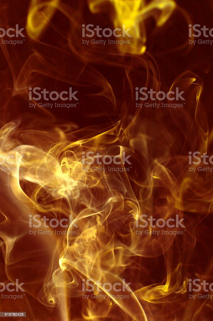 Gold smoke, ink or flame stock photo