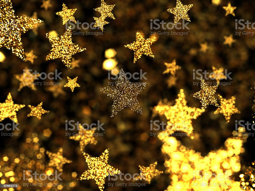 Gold stars with some out of focus stock photo