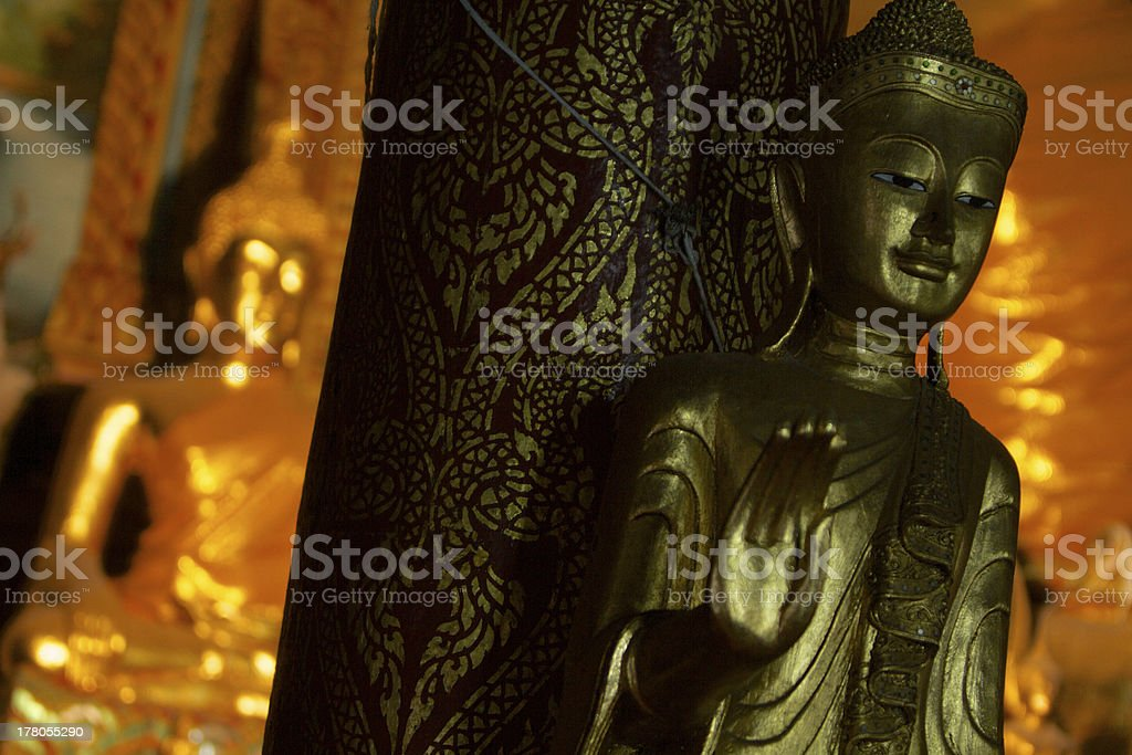 Gold statue in the Temple stock photo
